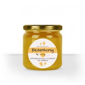 """Rundes Etikett """"Honigliebe"""" auf Honigglas"""